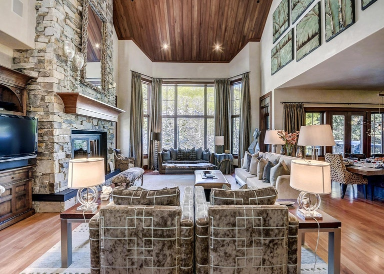 Lounge area with high ceilings and large windows in one of Beaver Creek's home rentals