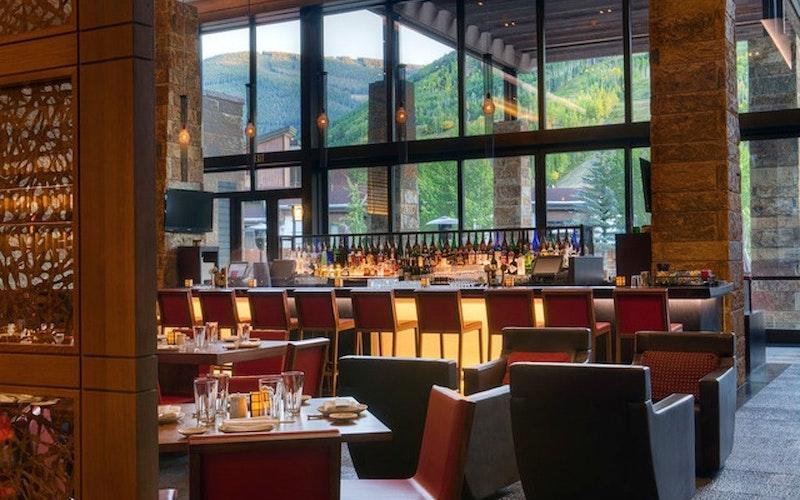 Modern dining area overlooking lush greenery at Solaris Residences.