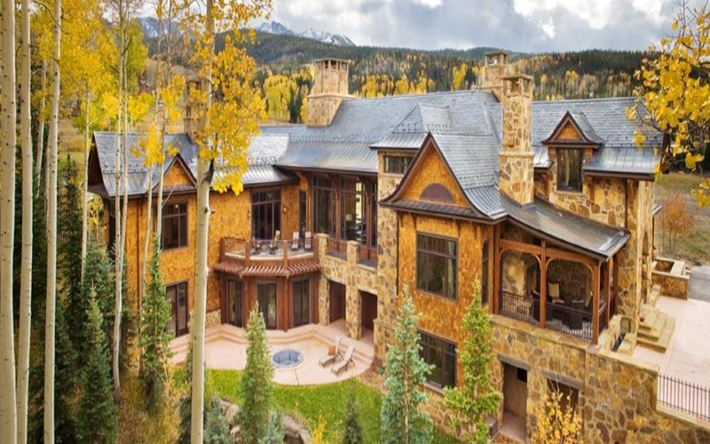 Large luxurious house amongst trees in Telluride village.
