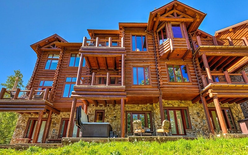 Triple story house with wooden exterior in Telluride Mountain Village.