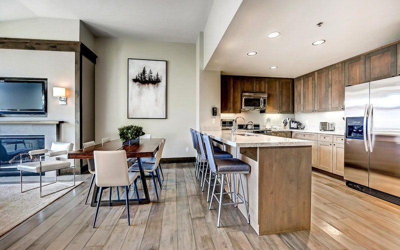 Modern dining room and kitchen of 551 Riverfront Resort.